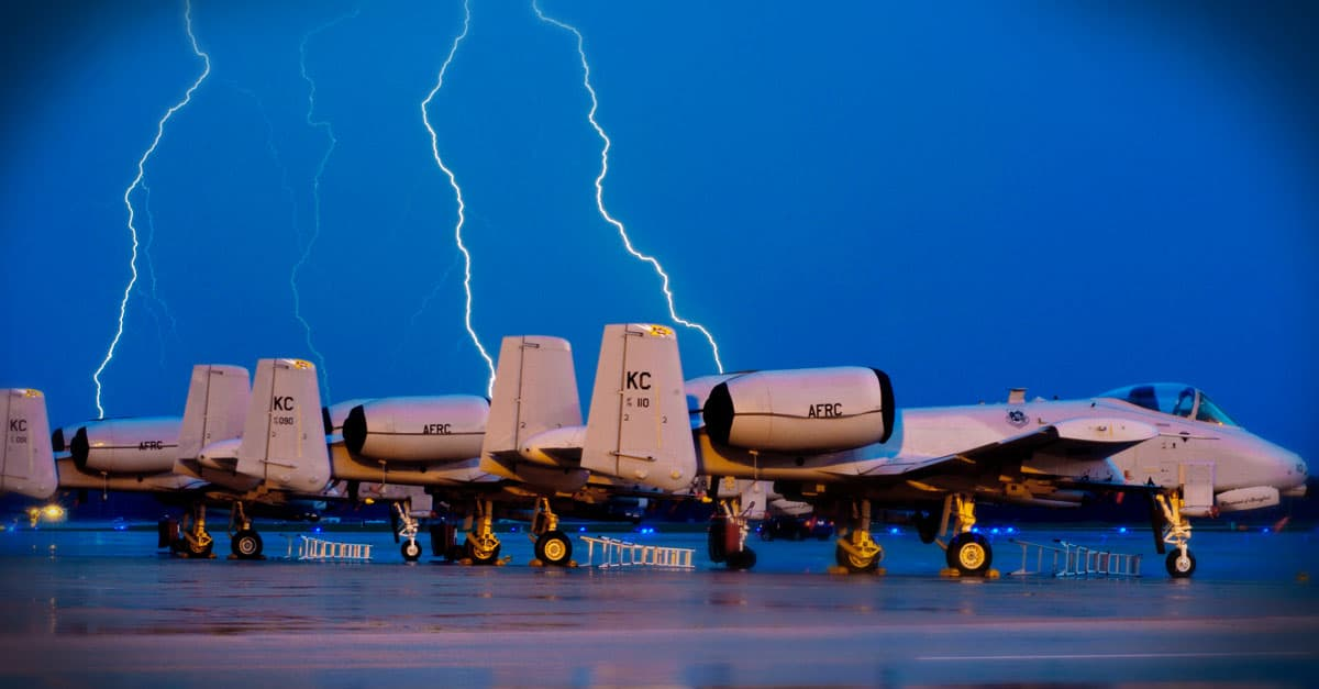 A-10-Lighting strikes behind A-10 Thunderbolt IIs on the Whiteman Air Force Base