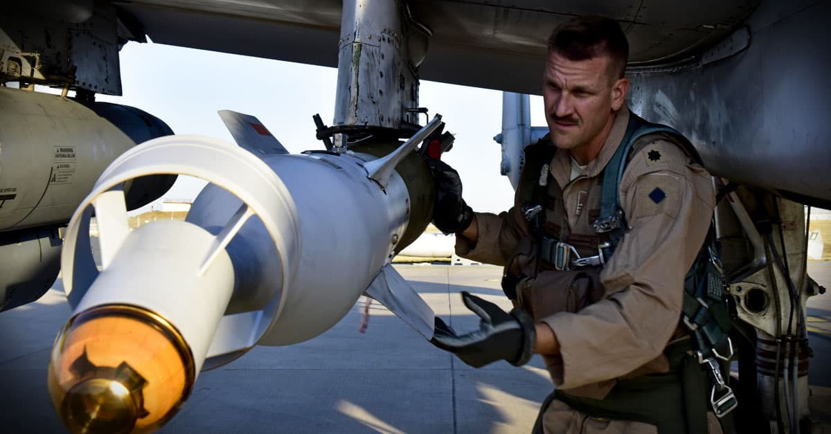 A-10_ Support Squadron commander conducts a preflight munitions check on an A-10 Thunderbolt II