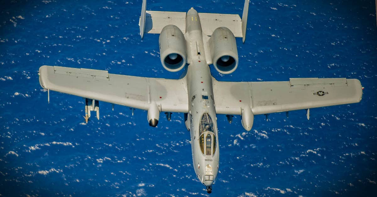 A-10_ flies over the Atlantic Ocean during the National Salute to America's Heroes Air and Sea Show media day