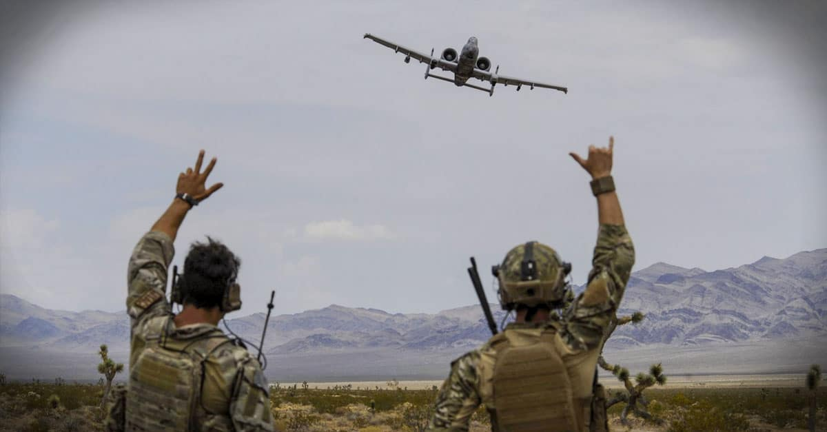 A-10_Joint terminal attack controllers wave at an A-10 Thunderbolt II