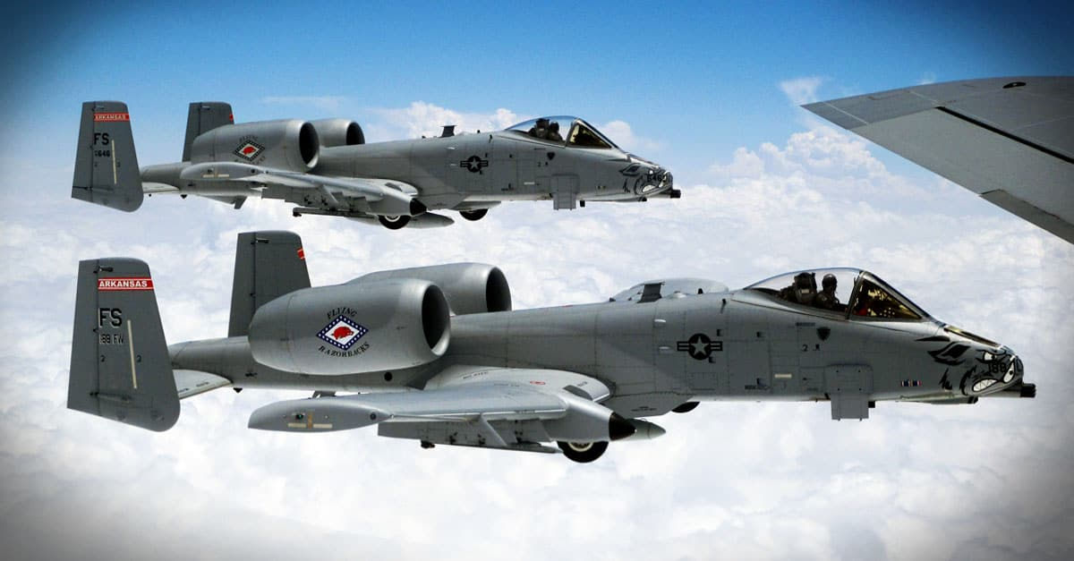 A-10_Two A-10 aircrafts fly in formation off the wing a KC-135 Stratotanker