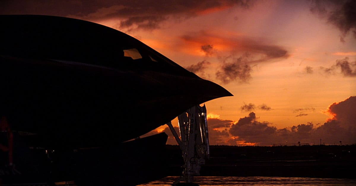 B-2-A B-2 Spirit bomber from Whiteman Air Force Base, Mo., is silhouetted by a Pacific sunset