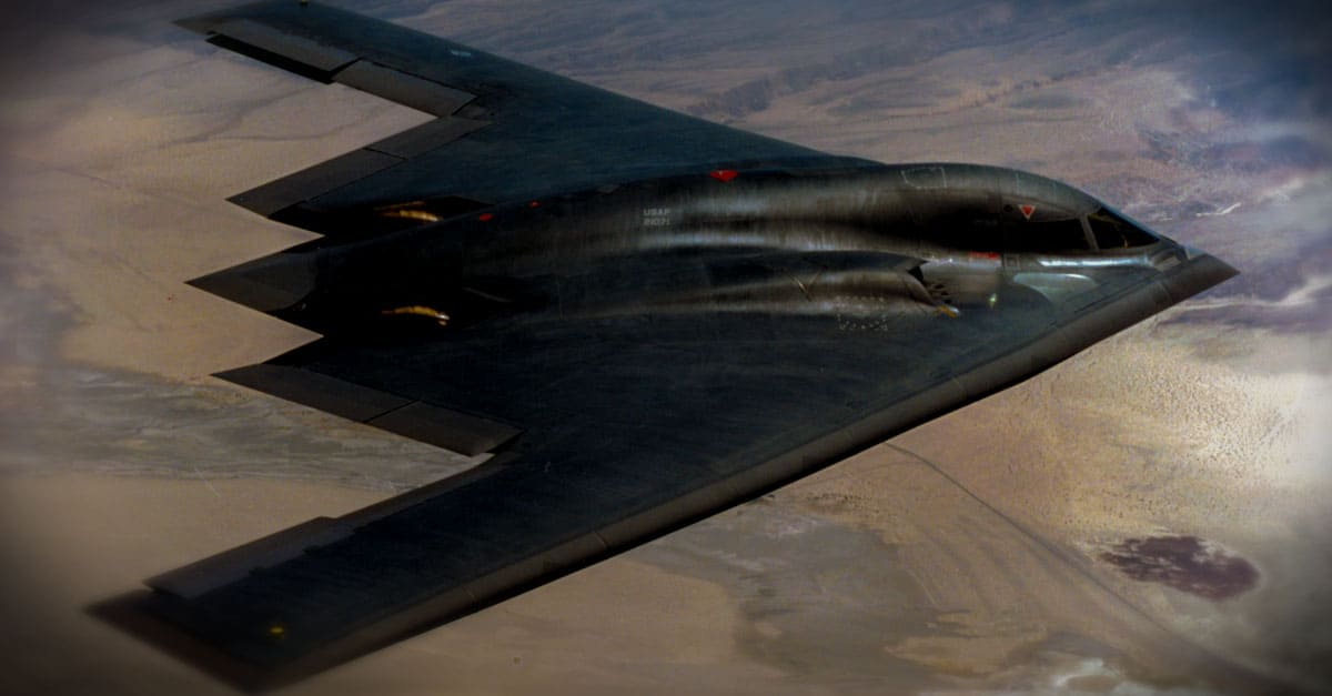 B-2- A B-2 Spirit flying over landscape