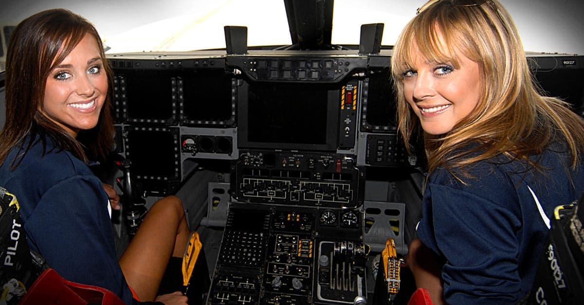 B-2 Broncos cheerleaders check out B-2 cockpit during tour