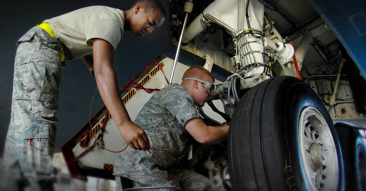 B-2_ Aircraft Maintenance Squadron safety wires a brake bleed on a B-2 Spirit