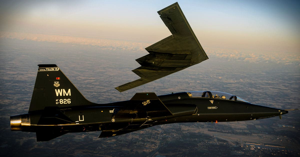 B-2_A T-38 Talon flies in formation with the B-2 Spirit