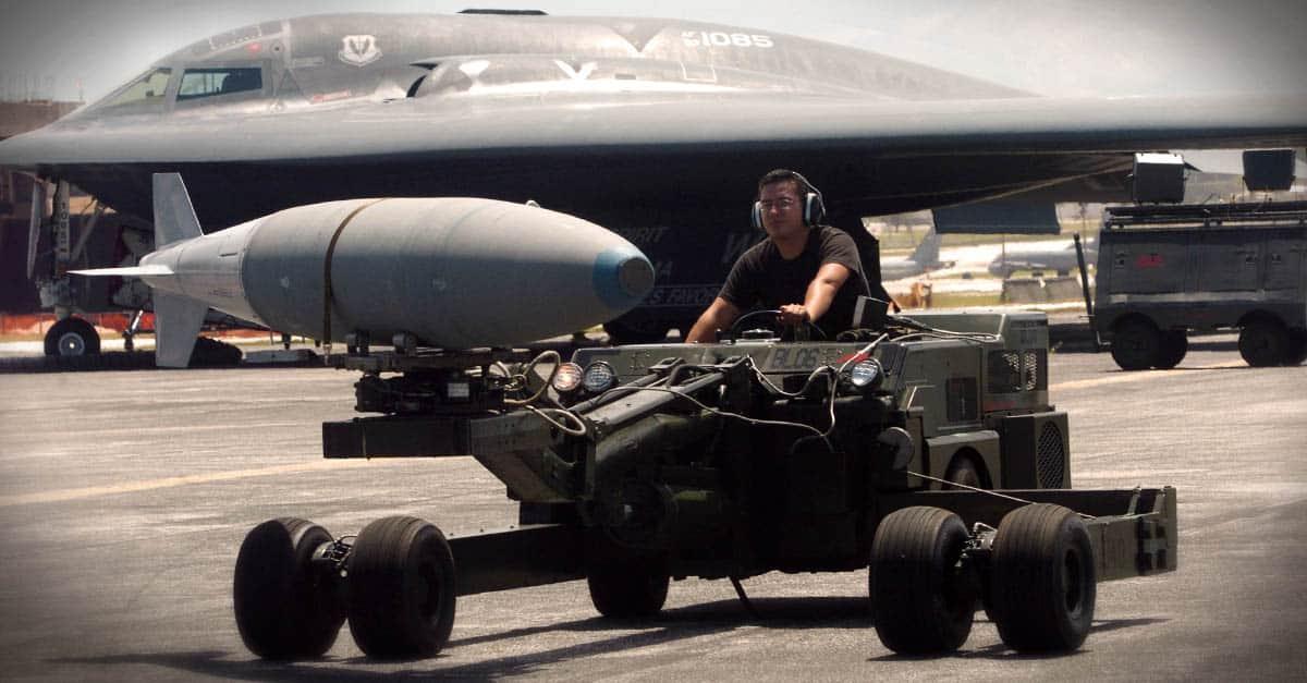 B-2_Senior Airman Phillip Ruiz moves a bomb to be loaded onto a B-2 Spirit bomber