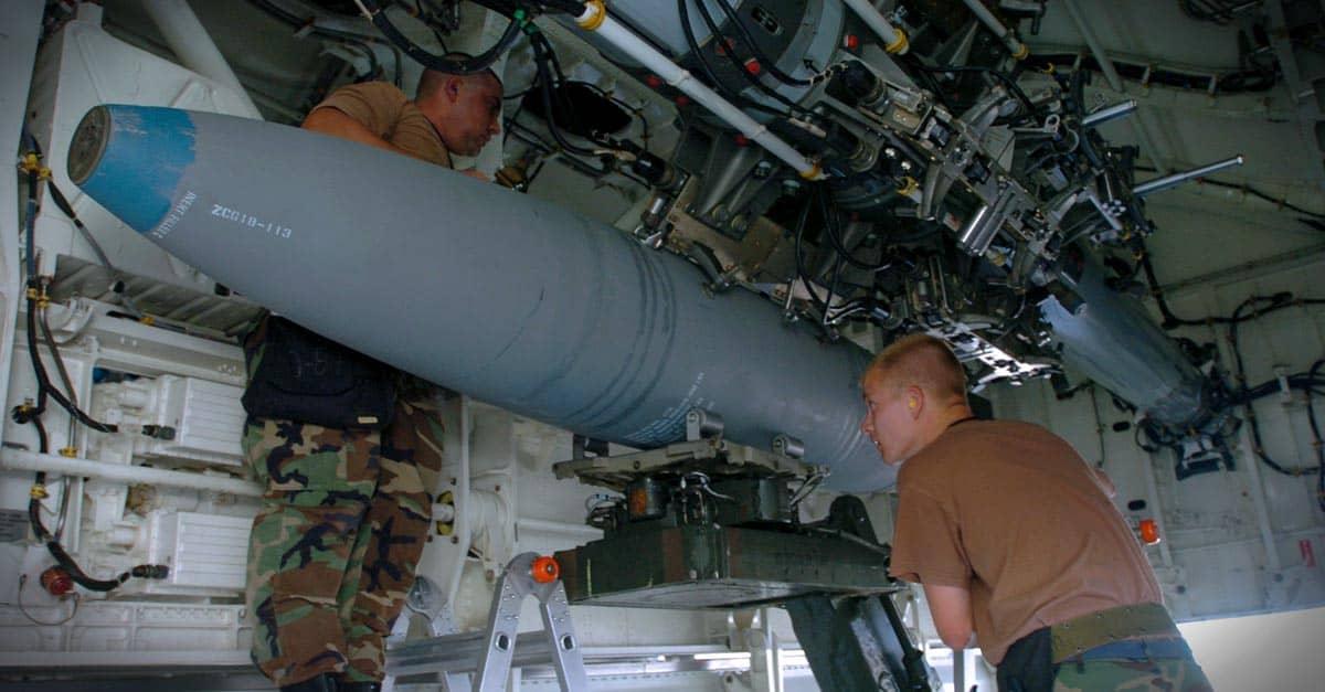 B-2_Staff Sgt. Michael Taylor and Senior Airman Joseph Nelson load a bomb on a B-2 Spirit bomber