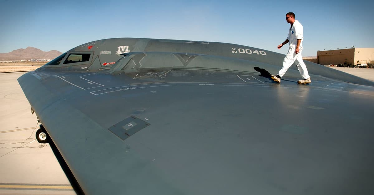 B-2_Tech. Sgt. Kevin Ponton examines the wing surface of a B-2