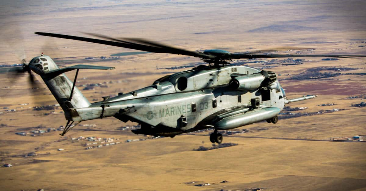 CH-53E-A CH-53E flies over Buckley Air Force Base during a familiarization course