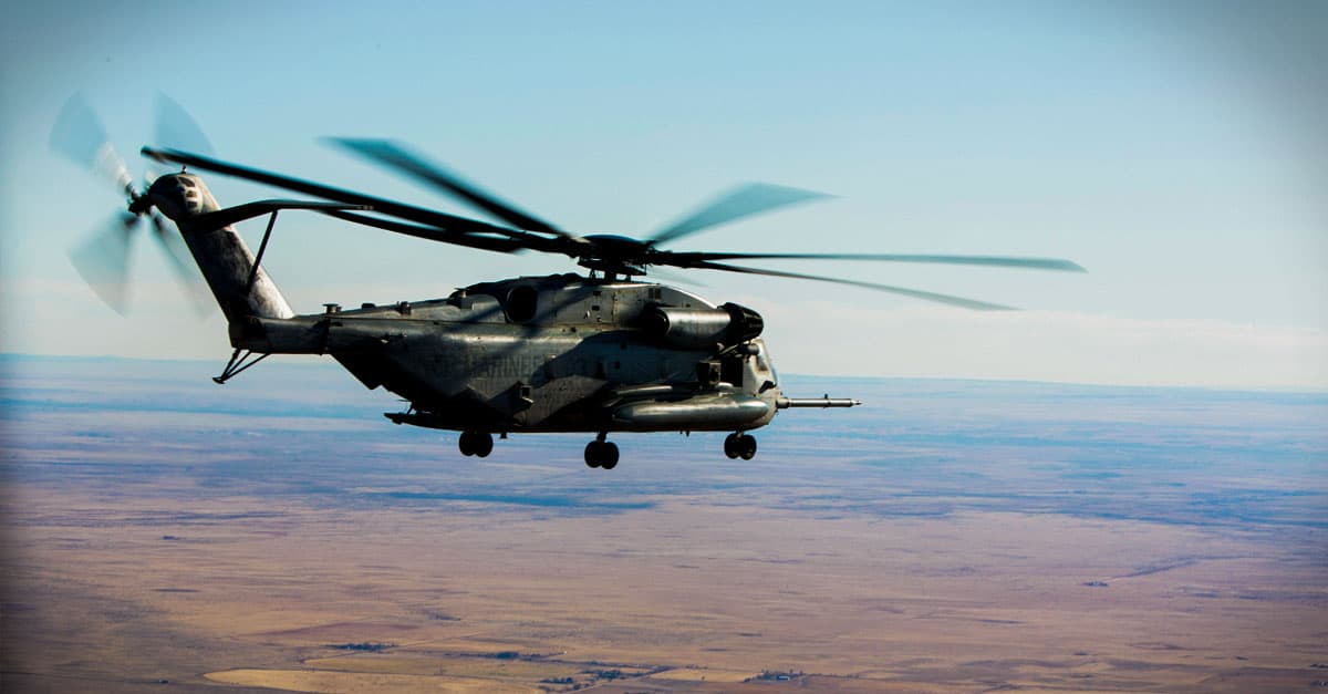 CH-53E-A CH-53E flies over Buckley Air Force Base during a familiarization course different angle