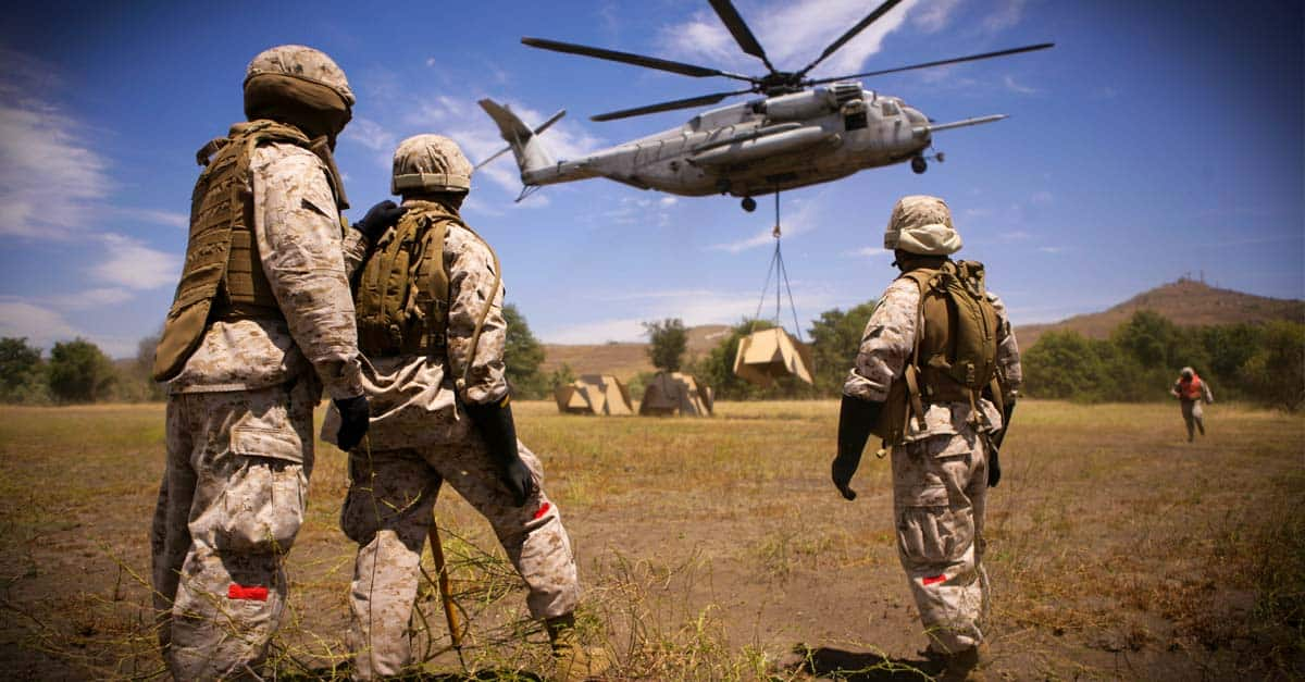 CH-53E-Marines with Helicopter Support Team watch pound target lifted by a CH-53E