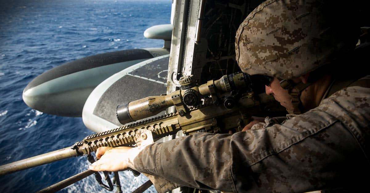 H-53E_ Marine Cpl. Jakob Stark practices aerial sniping from a CH-53E Super Stallion