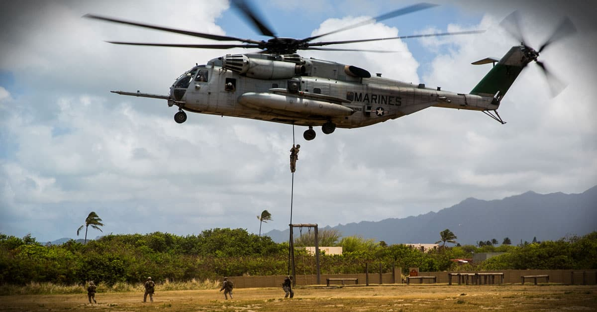 CH-53E_ Marines fast rope out of a CH-53E Super Stallion aboard Marine Corps Base Hawaii