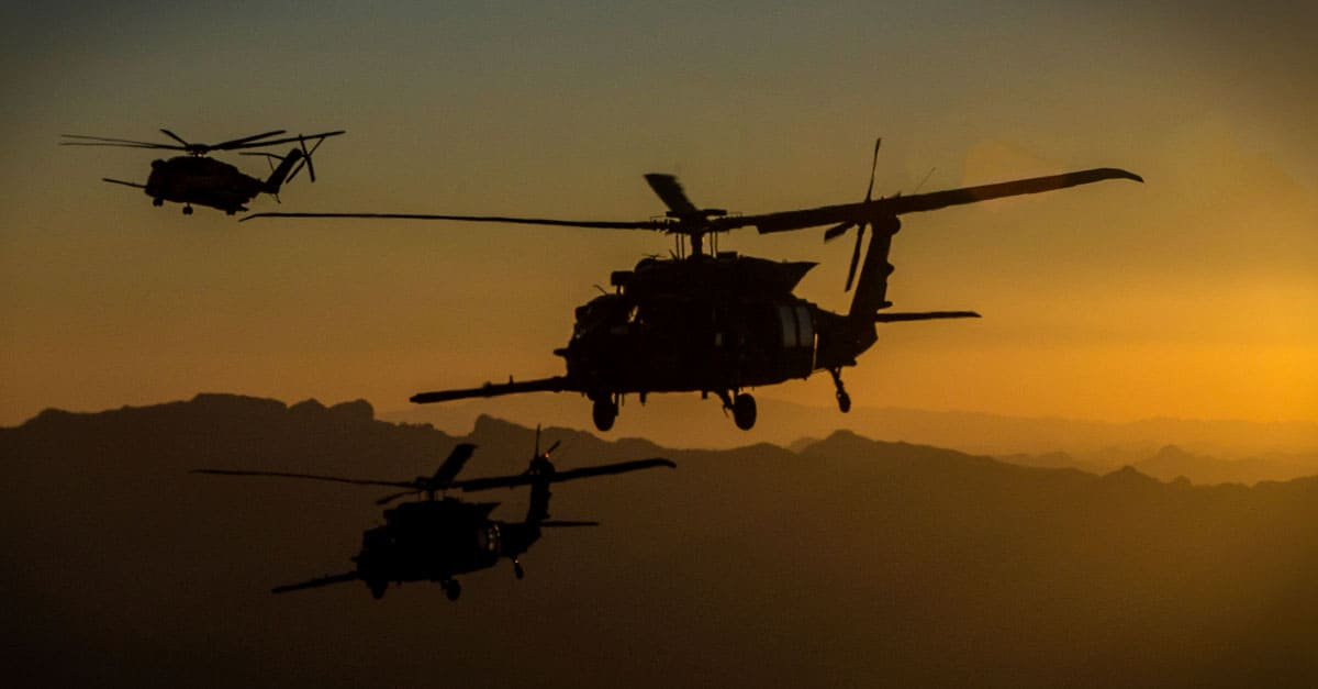 CH-53E_ a CH-53E and two MH-60M Blackhawks conduct an aerial refueling exercise