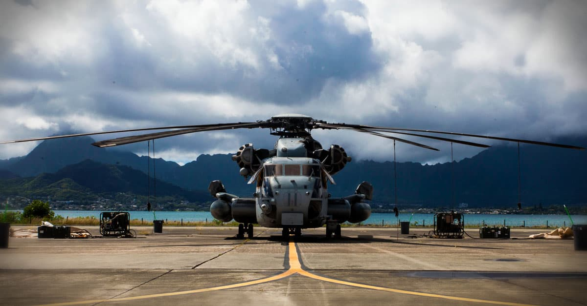 CH-53E_A CH-53E is flanked by pumps and cleaning equipment prior to a detailed aircraft decontamination