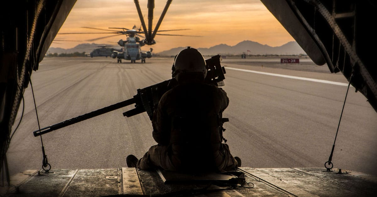 CH-53E_A Marine prepares for take-off on a CH-53E Super Stallion during a CH-53 day battle drill
