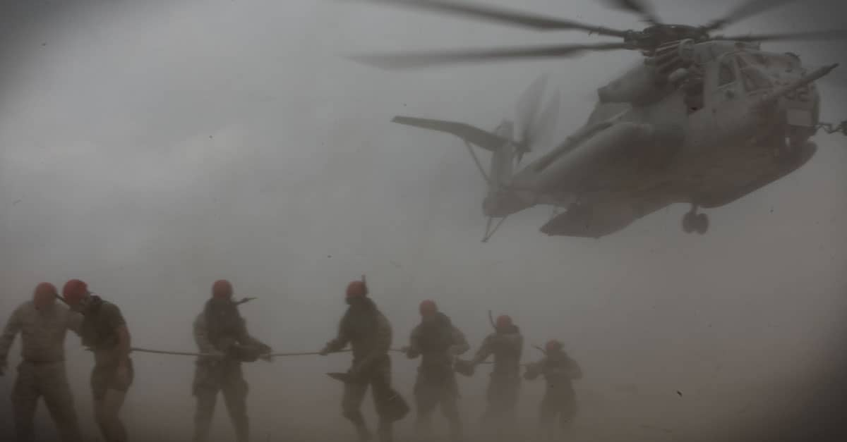 CH-53E_Marines and sailors are lowered to the ground during their cast master course