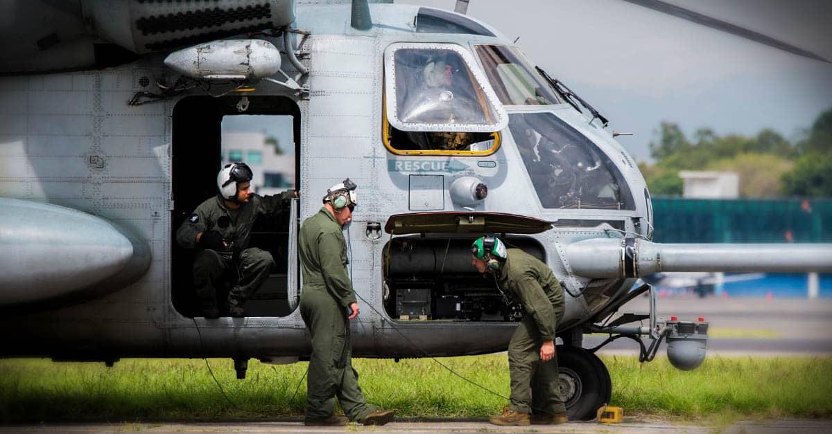 CH-53E_Marines check over their CH-53E Super Stallion helicopter before departing La Aurora