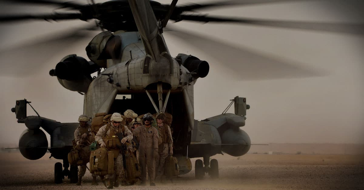 CH-53E_Marines offload from a Marine CH-53 Super Stallion helicopter